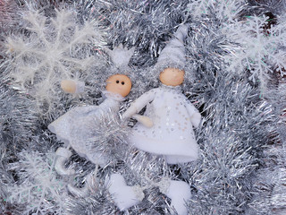 Two Dolls on Icicles Background
