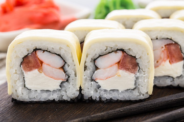 Sushi rolls with shrimps and cheddar cheese