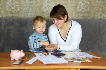 boy with his mother engaged in household finances