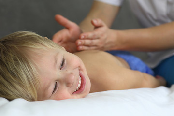 funny little boy with a massage