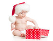 Baby in Santa hat with Christmas gift box isolated
