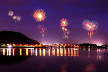 Fireworks celebrating over Lake Kawaguchiko at night with mount