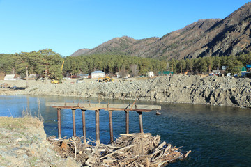 The destroyed bridge at the mountain river
