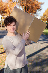 Woman wearing large package on the shoulder