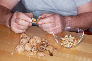 Man opens walnuts