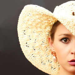 Beautiful fashion model with big straw hat