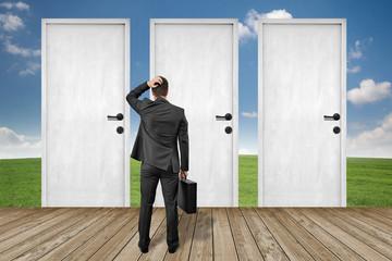 man standing in front of doors