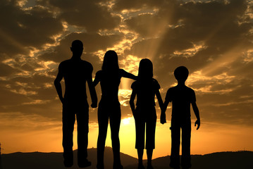 Family facing to the sunrise against a red sky