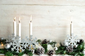 Snow flakes ornament balls,candles and fir leaves