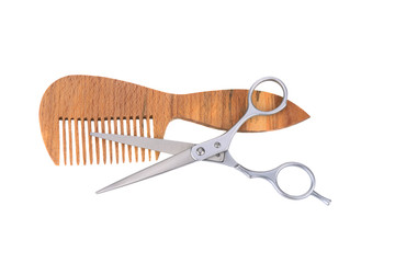 .scissors and a wooden comb