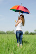 Beautiful girl with a multi-coloured umbrella