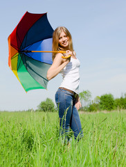 Beautiful girl with a multi-coloured umbrella