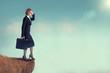 businesswoman on the edge of a cliff