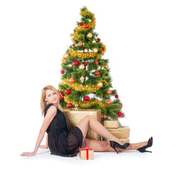 Beautiful blond smiling woman and Christmas tree