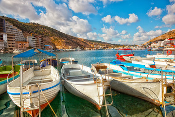 Boats in Balaklava Bay in the sunny summer day,  Crimea