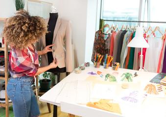 Fashion designer measuring a blazer