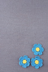 knitted flowers on the background