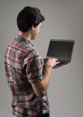 rear view of a man with laptop