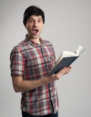 surprised man with book