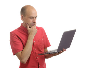 casual bald man with laptop thinking