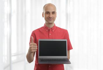 smiling bald man with laptop
