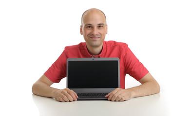 smiling bald man presenting something on laptop