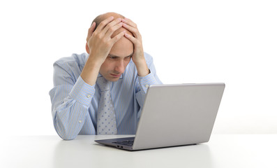 worried businessman looking at his laptop