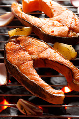 Grilled salmon steak with herbs and spices