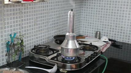 Indian woman in the kitchen preparing a national porridge