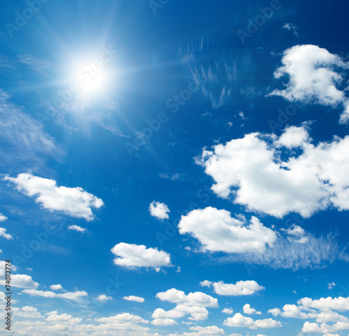 blue sky background with tiny clouds - 74073774