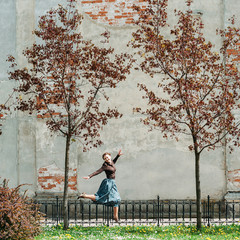 Girl jumping between trees.