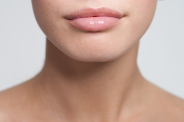 Close up of woman's mouth and shoulders