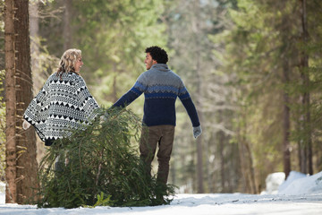 Man and woman with fresh cut Christmas tree