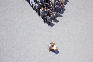 Man at apex of crowd
