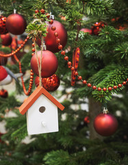 Christmas tree decoration with wooden house ornament