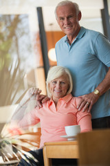 Older couple relaxing together in kitchen