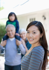 Woman smiling with family outdoors