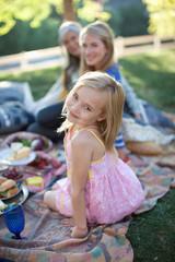 Three generations of women picnicking