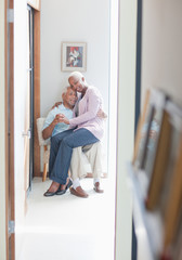Older couple sitting together indoors