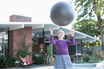 Girl playing with ball outdoors