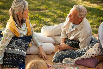 Older couple relaxing on blanket outdoors