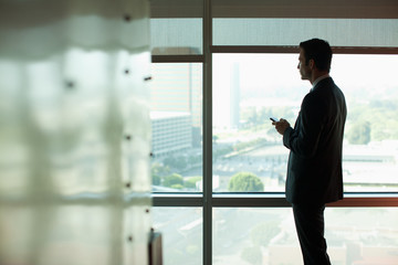Silhouette of businessman using cell phone