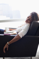 Businesswoman sleeping in office chair