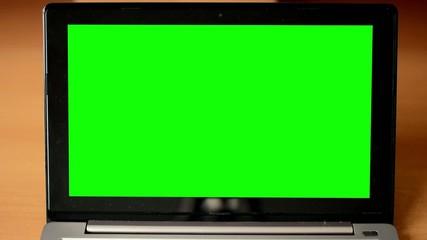notebook monitor green screen - table - closeup