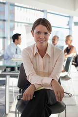 Smiling businesswoman sitting in office