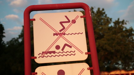 Sign for a ban on swimming