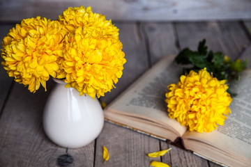 Flowers. Beautiful yellow chrysanthemum in a vintage vase.