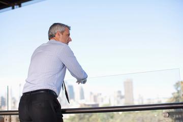 Businessman on balcony