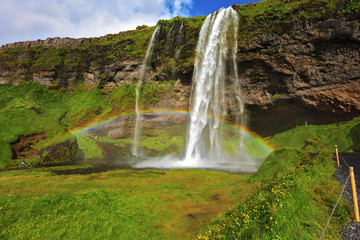Seljalandsfoss waterfall in sunny day