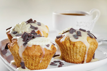 Delicious muffins with chocolate decoration